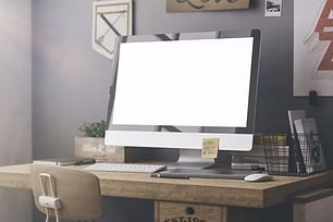 Stylish workspace with computer and posters on home or studio.jpg