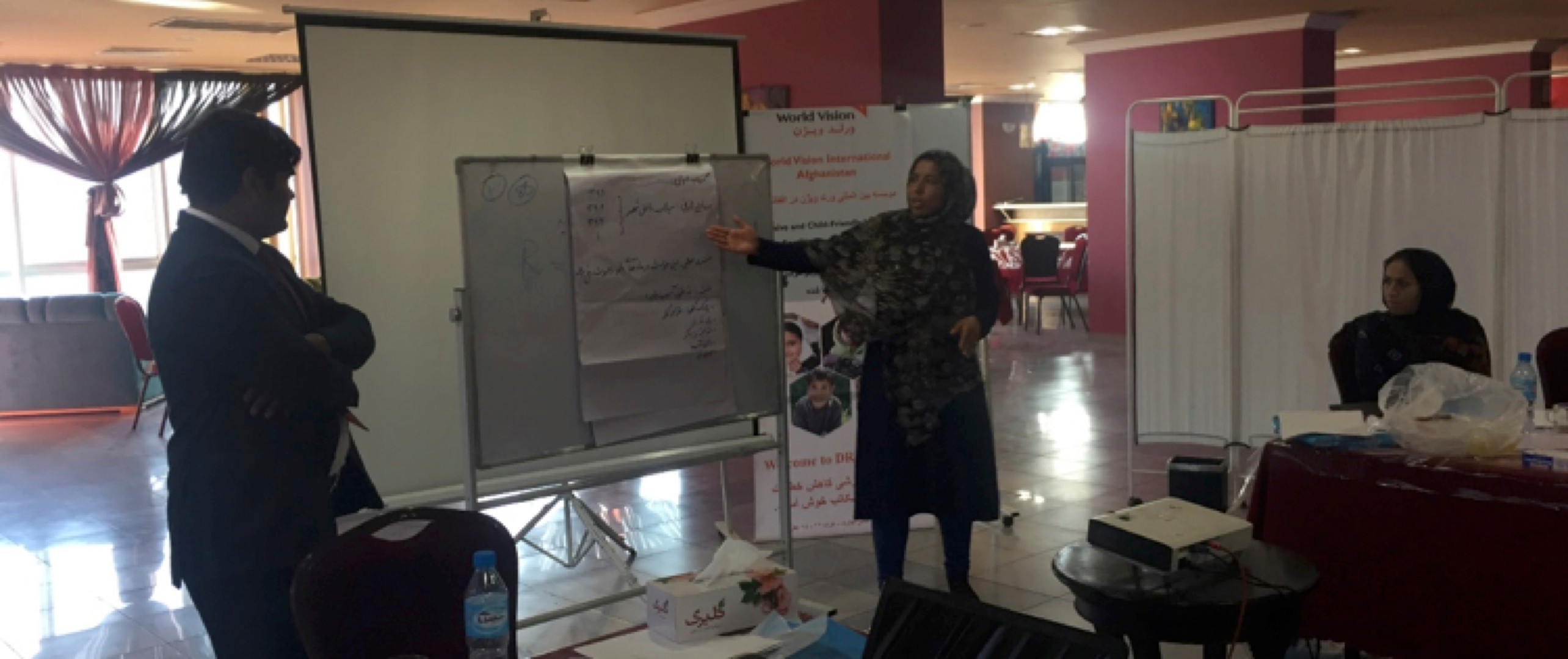 Participant presenting their group work and share their agreed school's disaster profile, seasonal calendar and hazard map