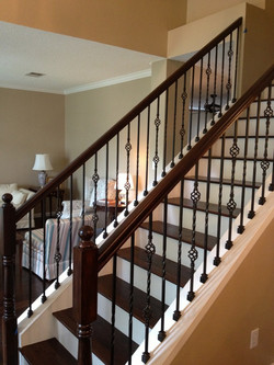 Wrought-Iron-Balusters-at-Stairs-with-Wood-Treads-768x1024