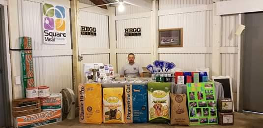 Travis Thompson (Owner) sitting at the Hegg Mill Booth at the Trempealeau County Fair