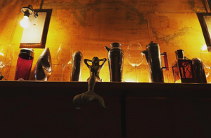 Captain Gregory's Speakeasy Alexandria: A photo of the backroom with a bar and small mermaid statue