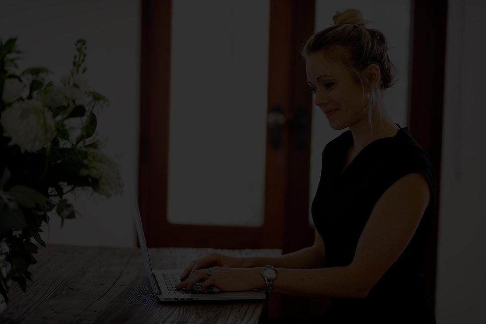 Grace-on-desk-black-and-white.jpg