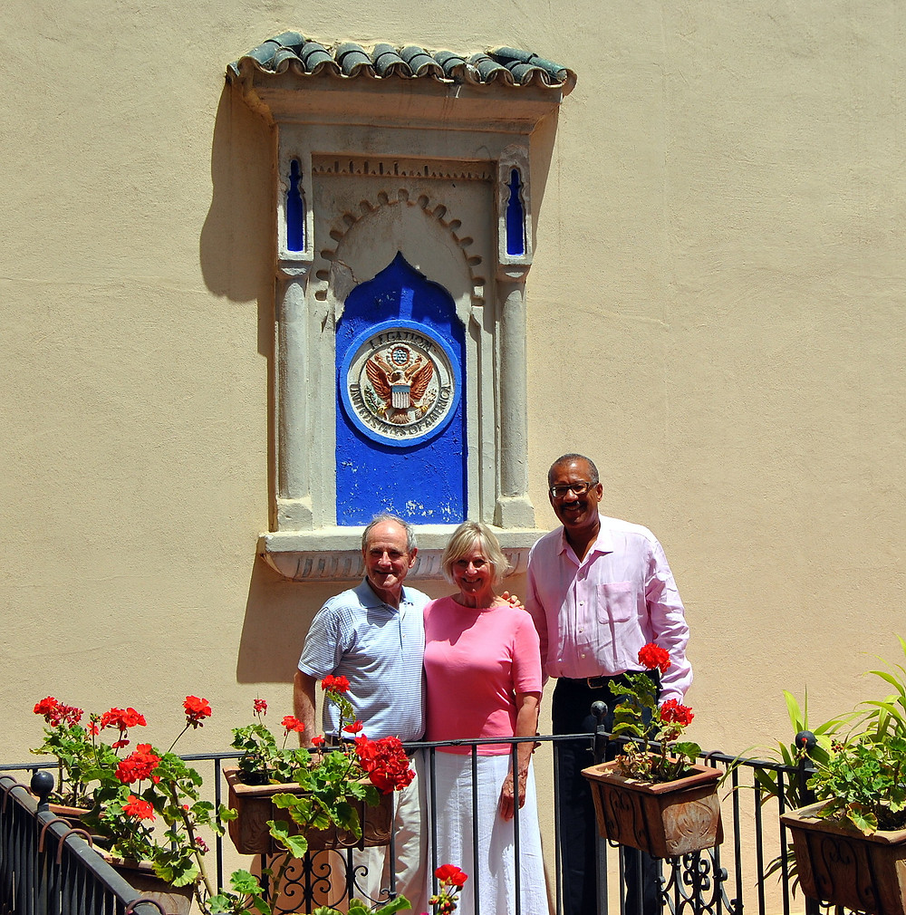 From left to right: Senator James E. Risch, his wife Vicki and Ambassador Dwight Bush under the old Legation seal.