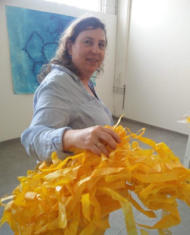 Alejandra Okret working on the installation Regalame un sol