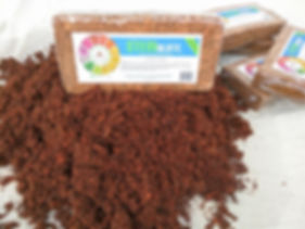 coconut coir briquettes with label on top of hydrated coconut coir