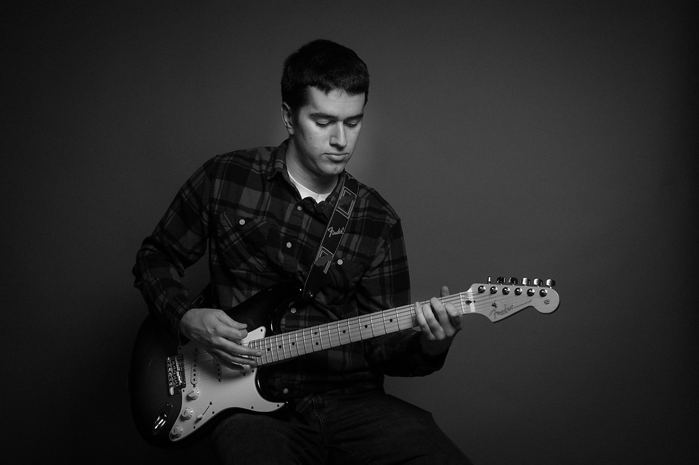 New England Musician Randy McGravey playing electric guitar