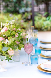 Spring flowers in vintage urns blue and blush