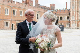 Blush and white protea and English garden rose bouquet at Eton College Chapel