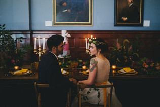 Jewel-toned table with plum and mustard toned garland