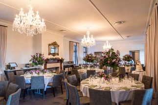 Tall purple and green centrepieces at Gunner's Barracks