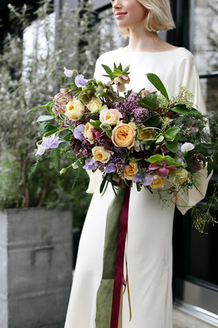 Luxe garden-style spring bouquet in lilac and peach