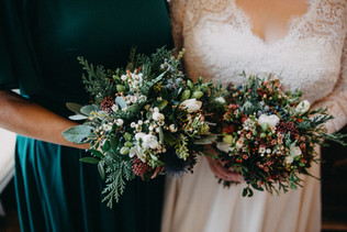 Winter bridal and bridesmaid bouquet for Finnish wedding at Cantley House Hotel