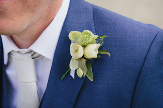 White, blue and green buttonhole