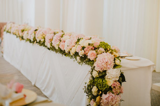 Pink, gold and white head table garland to floor