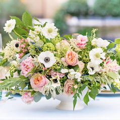 Spring flowers in vintage urn centrepiece