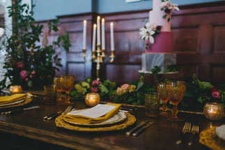 Plum and mustard toned table garland at The Oval