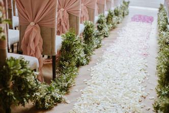 Foliage garland and ombre petal aisle