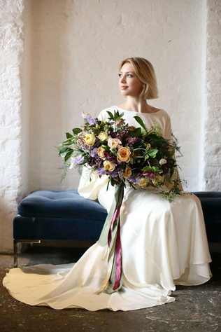 Luxe garden-style spring bouquet in peach and lilac