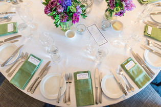 Rich purple and green centrepieces at Gunner's Barracks
