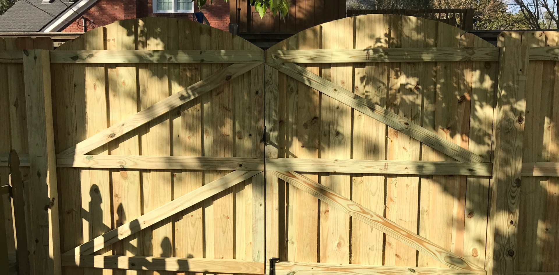 Board on Board with Arch Gates and Pergola