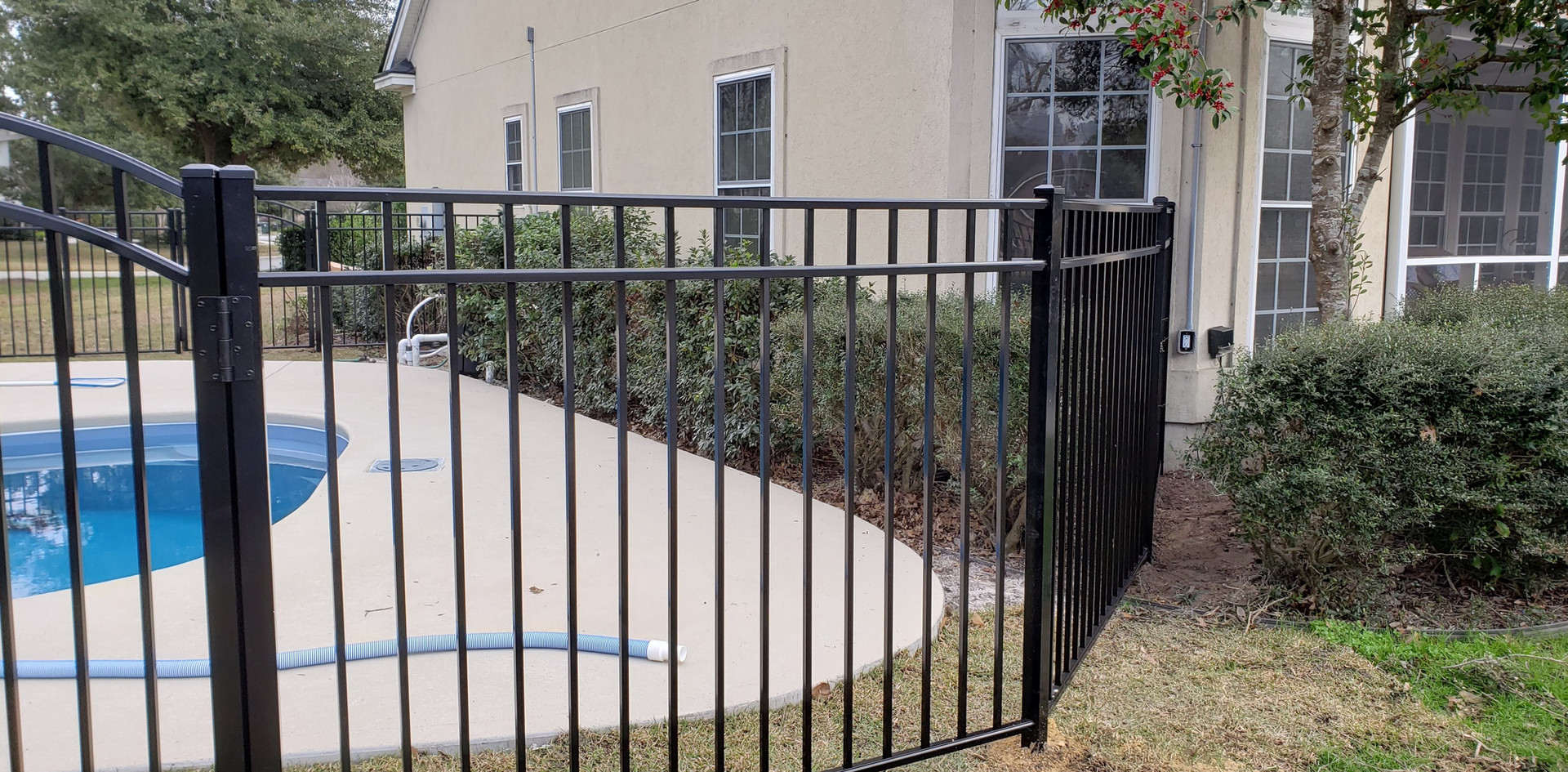 Rail fence with arch gate