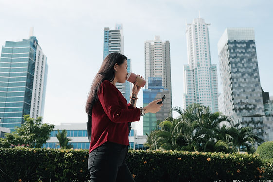 chinese-woman-with-phone-walking-and-dri