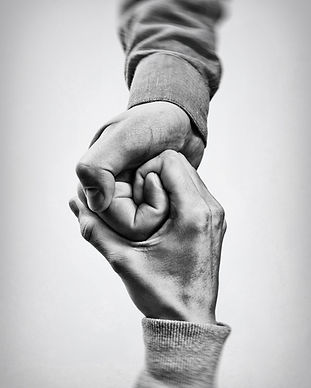 A firm handshake between two partners. B