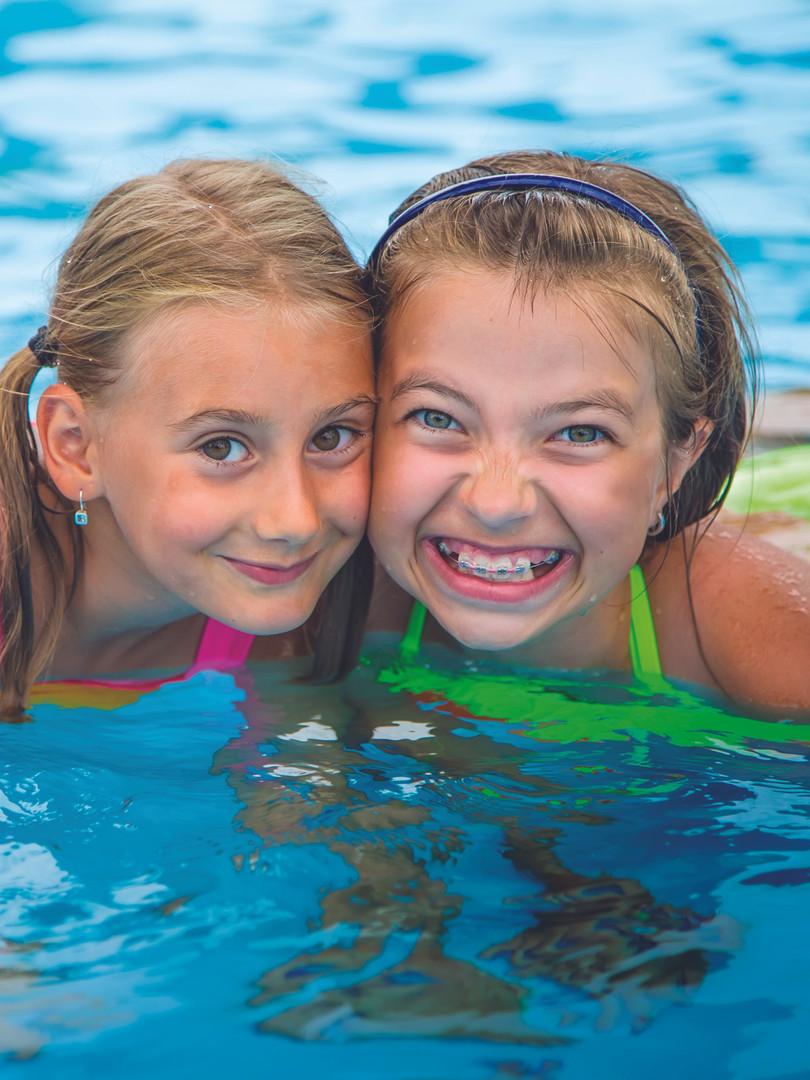 iStock-586946934-poolGirlsFLAT.jpg