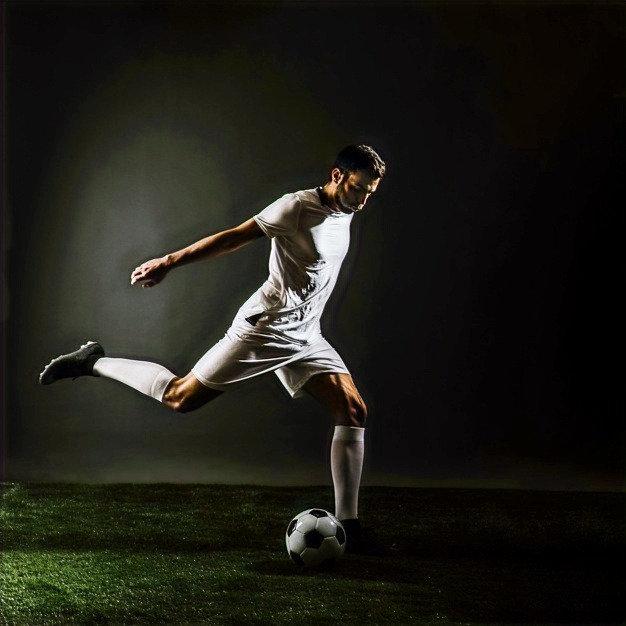 soccer-player-shooting-ball_23-214781730