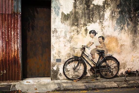 Penang children on bike.jpg