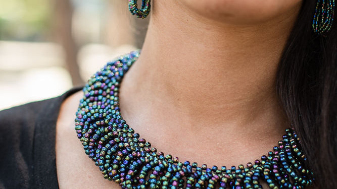 Necklace braided with beads in loops
