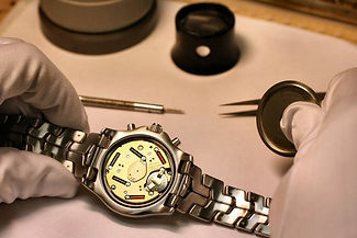 Watch battery replacement, knife sharpening, purse repairs