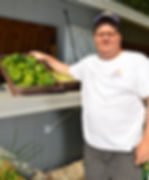 Joe at farmstand pic.JPG