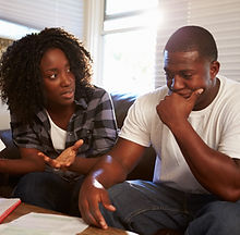 bigstock-Worried-Young-Couple-Sitting-O-