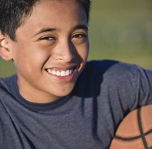 bigstock-Hispanic-boy-holding-basketbal-