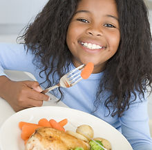 bigstock-Young-Girl-In-Kitchen-Eating-C-