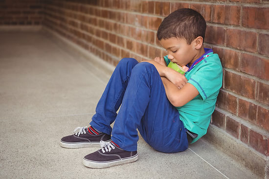 bigstock-Upset-lonely-child-sitting-by--