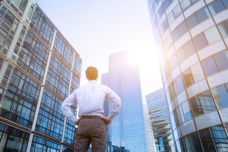 Man Standing in front of Skyscrapers