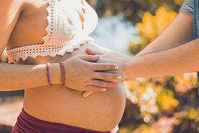 Canva - Parent Hands Touching Pregnant W