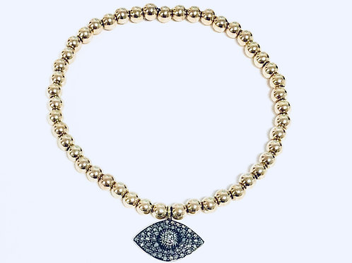 Gold filled beaded bracelet with pave diamond hamsa charm