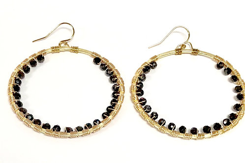 """Cerchio 2 1/4"""" round gold plated earrings with brown crystal beads."""