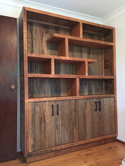 Custom shelving unit with cupboard.