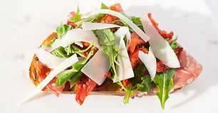 Parma ham, mozzarella, green pesto, sun-