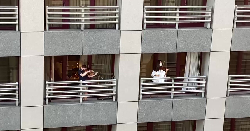 Matthew Lipman and Kristin Lee's balcony concert while quarantining at a hotel in Taipei