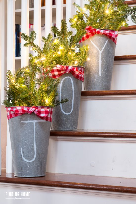 Lighted Joy Buckets on Stairs