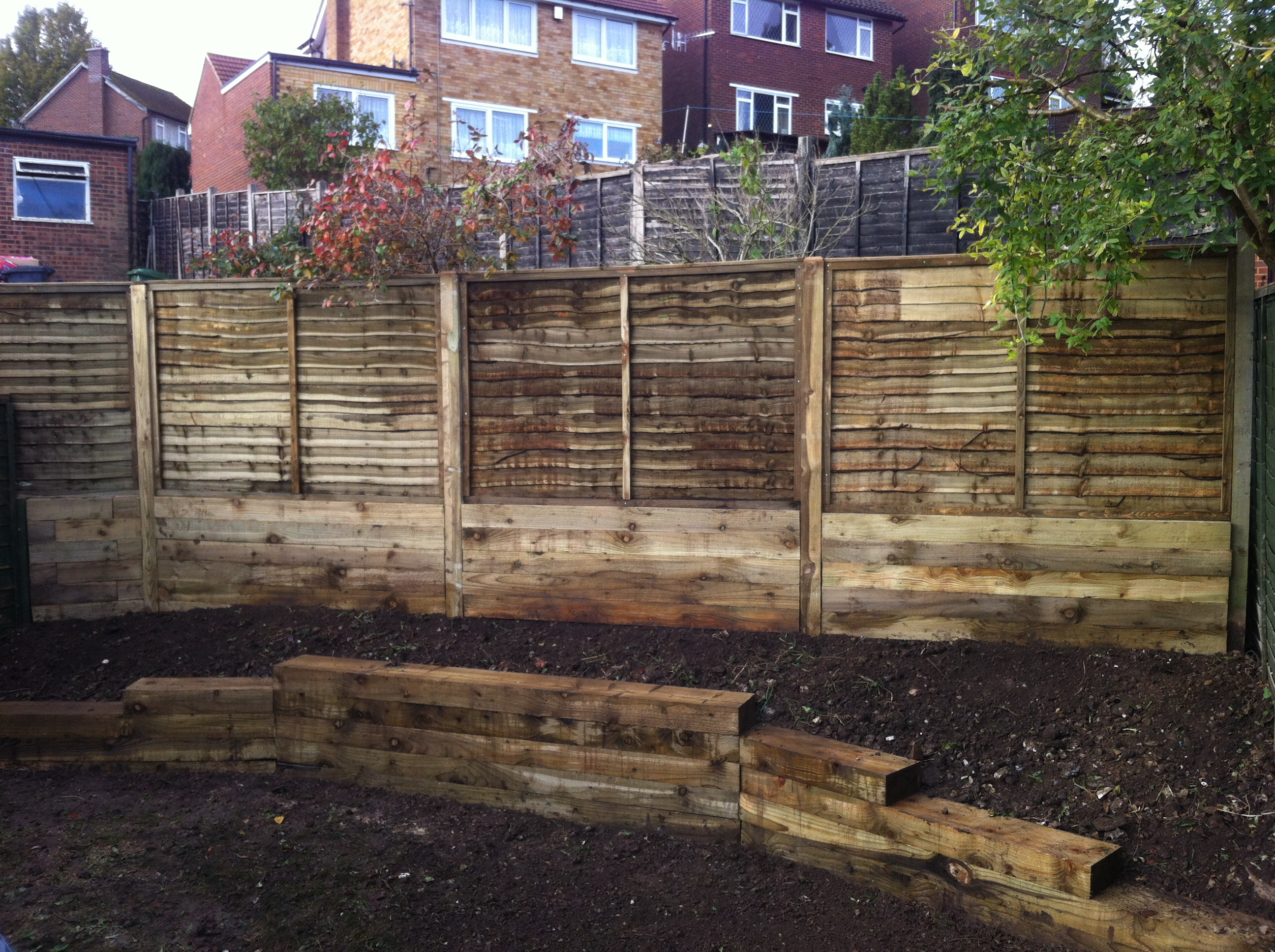 Sleeper retaining wall and fencing