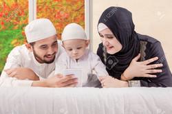 80148652-portrait-of-happy-muslim-family