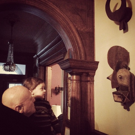 showing his grandson Henry some masks
