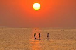 Paddleboards at sunrise