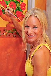 Owner Cristie painting